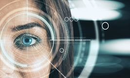 Digital blue eye interface wallpaper. Abstract digital blue eye interface wallpaper. Biometrics and scanning concept. Double exposure royalty free stock image