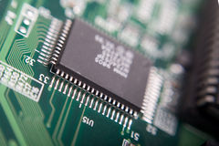 Digital board background. Motherboard's green electronic circuit - macro with shallow depth of field Royalty Free Stock Photo