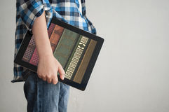 Digital books in tablet Stock Images