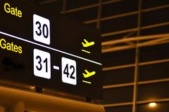 Digital bulletin board with airport gateway signs. Night royalty free stock photo