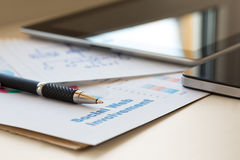 Digital Business Composition with two Gadgets Pen and Papers Royalty Free Stock Images