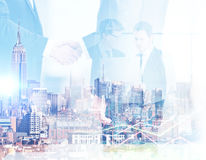 Digital business concept. Abstract image of businessmen using laptop and shaking hands on city background. Digital business concept. Double exposure Stock Photography