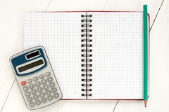 Digital calculator and spiral notebook Stock Photography