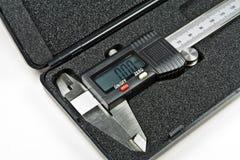 Digital caliper. Silver digital caliper in its own hard box. Isolated on white background stock photo
