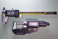 Digital caliper and a digital micrometer.  stock photo
