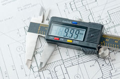 Digital Caliper on Drawing spec paper Stock Image