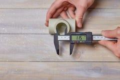 Digital calliper measurement. Measurement with digital calliper diameter of plastic pipe Stock Image