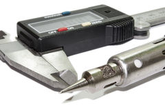 Digital calliper and soldering iron Royalty Free Stock Photography