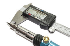 Digital calliper and soldering iron Royalty Free Stock Images