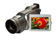 Digital camcorder with flower. Digital video camera  with floral picture on the screen isolated on white Royalty Free Stock Images