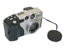 Digital camera. 3 Megapixel digital camera with lens cap off on white background royalty free stock photo