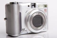 Digital camera. Black-white digital camera on white closed Royalty Free Stock Photos