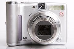 Digital camera. Black-white digital camera on white open front face Stock Photo