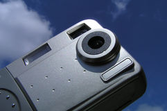 Digital camera. Against blue sky royalty free stock image