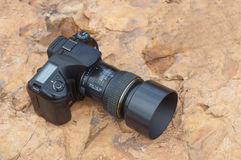 Digital camera. On a rock Royalty Free Stock Photography