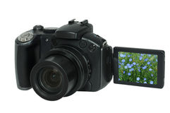 Digital camera. The digital camera on a white background Royalty Free Stock Photo
