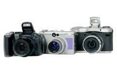 Digital camera. Three digital cameras on a white background Stock Photography