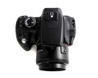 Digital camera. Photo of the black photo digital camera on the white background view from the top Royalty Free Stock Images