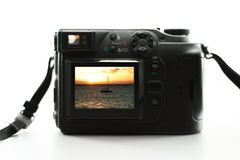 Digital camera. With a Hawaiian sunset on the LCD screen stock photography