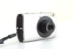 Digital camera. It is a isolated digital camera with a zoom lens Stock Images