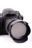 Digital camera. Close up shot of SLR camera on isolated background Royalty Free Stock Images