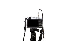 Digital camera on camera tripod, isolated on white background with copy space Stock Photography