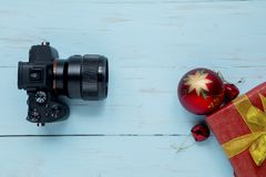 Digital camera with Christmas ball on the table royalty free stock photo
