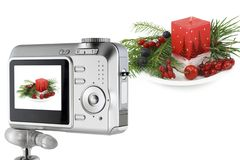 Digital camera and a Christmas bouquet collage Stock Photos