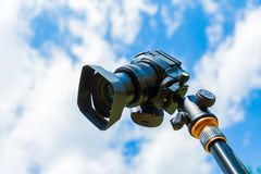 Digital camera closeup on a background of sky and clouds. Shooting on location and nature Royalty Free Stock Photography