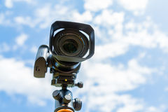 Digital camera closeup on a background of sky and clouds. Shooting on location and nature Royalty Free Stock Images