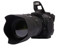 Digital Camera DSLR. A professional DSLR camera ready for a picture. Isolated on white Royalty Free Stock Photography
