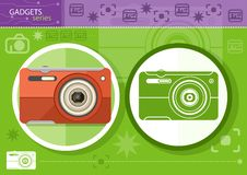 Digital camera in frame on green background Royalty Free Stock Photo