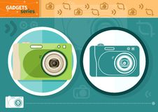 Digital camera in frame on green background Royalty Free Stock Images