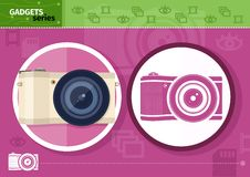 Digital camera in frame on lilac background Stock Photo