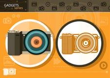 Digital camera in frame on orange background Royalty Free Stock Images