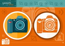 Digital camera in frame on orange background Royalty Free Stock Image