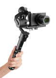 Digital camera with gimbal in hand Royalty Free Stock Photography