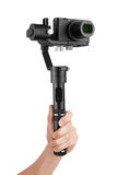 Digital camera with gimbal in hand Royalty Free Stock Image
