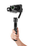 Digital camera with gimbal in hand Royalty Free Stock Photos