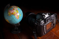 Digital camera with globe. Royalty Free Stock Image