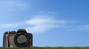 Digital camera on grass Stock Photo