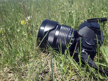 Digital camera on grass Royalty Free Stock Photos