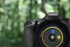 Digital camera. On green defocused background Stock Images