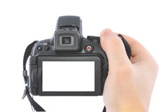 Digital camera in a hand Royalty Free Stock Images