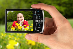 Digital camera in a hand Royalty Free Stock Photo
