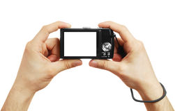 The digital camera in a hand Royalty Free Stock Photos