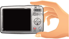 Digital camera and hand Stock Photography
