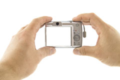 The digital camera in a hands. Isolated over white background Stock Photo