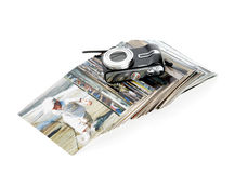 The digital camera and the heap of photos Royalty Free Stock Photo