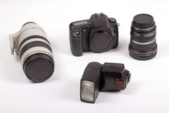 Digital Camera Kit. Digital slr camera with lenses and flashgun Royalty Free Stock Images